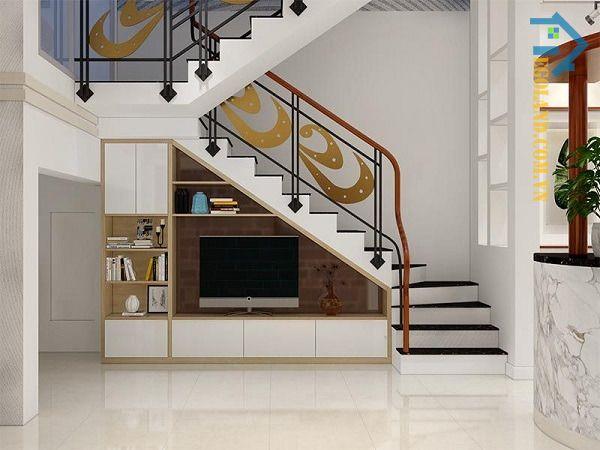 Mẫu tủ kệ tivi gầm cầu thang chất liệu gỗ MDF kết hợp giữa màu trắng và nâu sữa